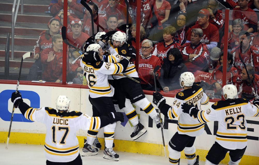 2a93fee43c5 Members of the Bruins celebrate with Tyler Seguin
