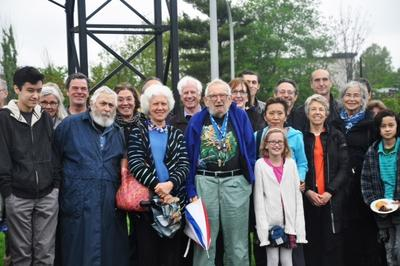 Bill and Clara Wainwright, center, in front of friends, family and supporters at the rededication ceremony of  Bill's 'Windwheels' sculpture (Courtesy)