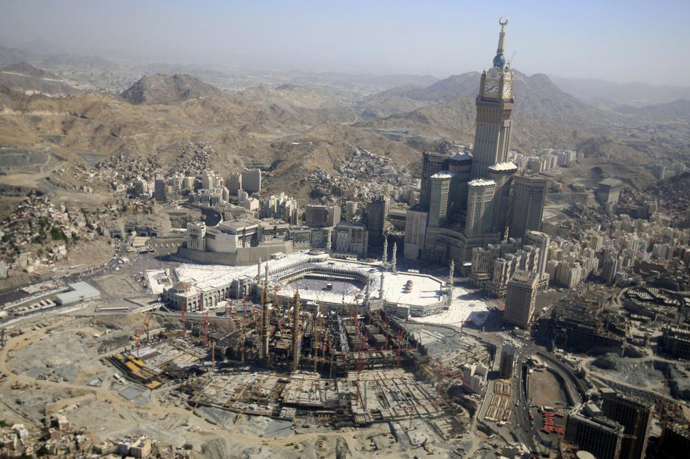 This aerial image made from a helicopter shows Muslim pilgrims moving around the Kaaba, the black cube seen at center, inside the Grand Mosque, during the annual Hajj in the Saudi holy city of Mecca, Saudi Arabia, Monday, Nov. 7, 2011. The annual Islamic pilgrimage draws 2.5 million visitors each year, making it the largest yearly gathering of people in the world. (AP)