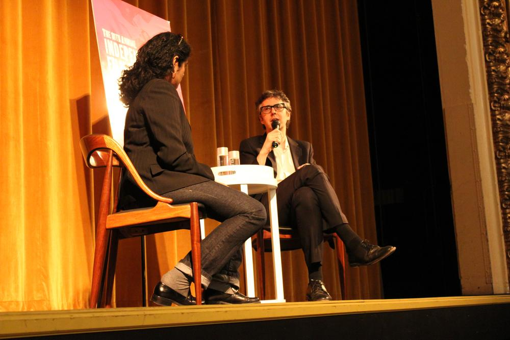 Ira Glass on stage at the Somerville Theatre with WBUR's Meghna Chakrabarti on Wednesday night. (Lisa Tobin/WBUR)