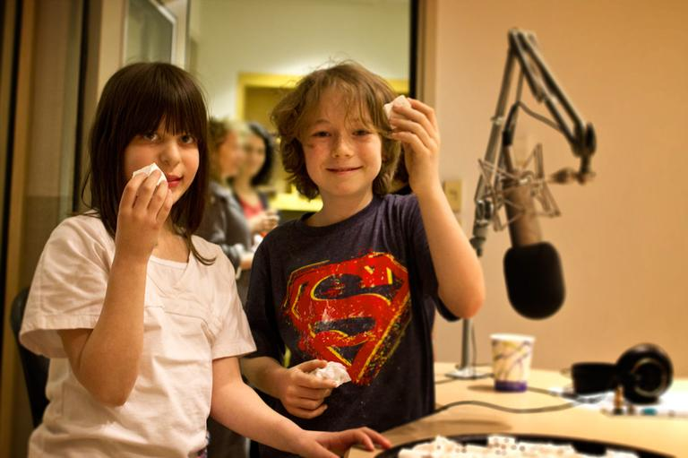 Jamie Wolpert (left) and Sammy Haines (right) test some marshmallows for us at Here & Now studios at WBUR in Boston. (Jesse Costa/Here & Now)