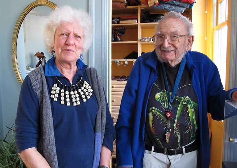 Bill and Clara Wainwright. Clara's necklace is one of the many pieces of art that Bill has created for her over the years. (Andrea Shea/WBUR)