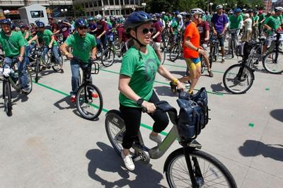 Riders all virtuously wearing their helmets when the Hubway bike-sharing program launched last summer (AP photo)