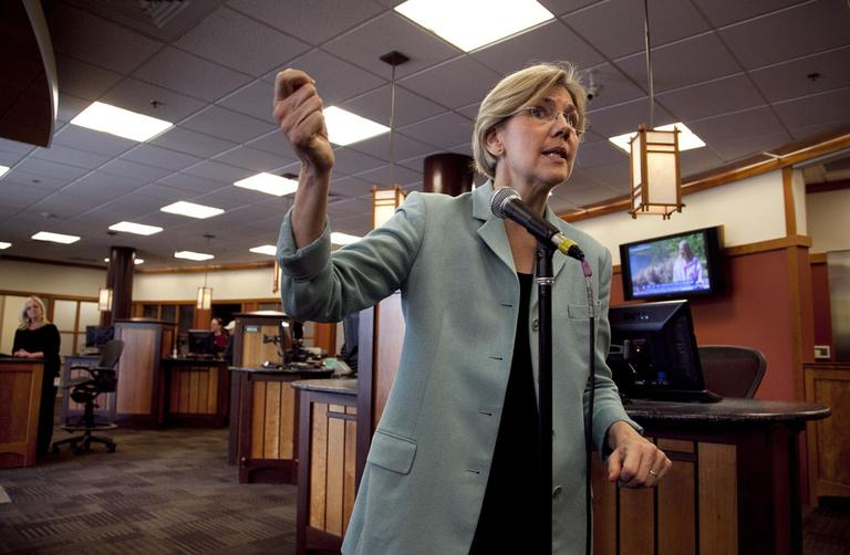 Democratic candidate for the U.S. Senate Elizabeth Warren faces reporters during a news conference at Liberty Bay Credit Union headquarters, in Braintree, Wednesday. (AP)