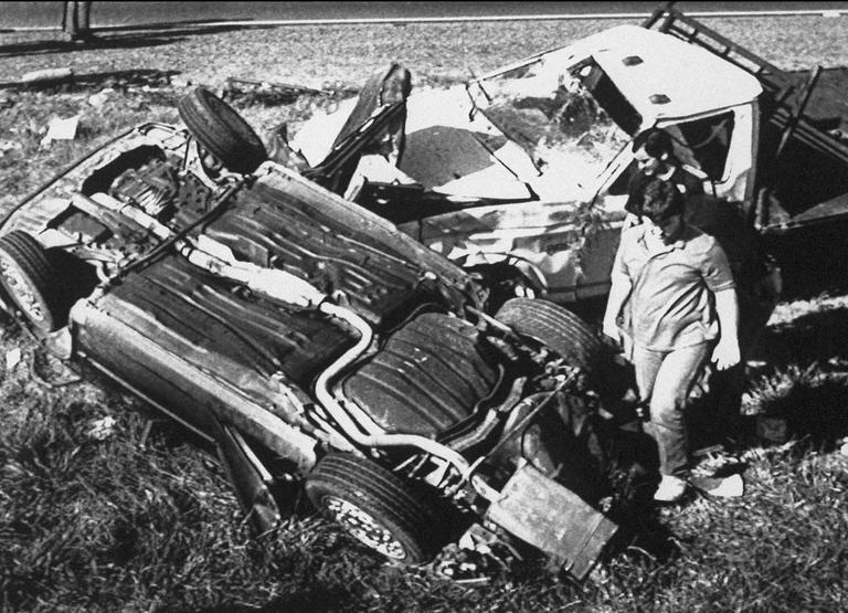 Police officials and others examine the wreckage of three-vehicle accident four miles west of Oxford, Mississippi on Thursday, March 26, 1987, that killed five University of Mississippi students who were participating in a sorority walk-a-thon. Several others were injured in the accident. (AP)