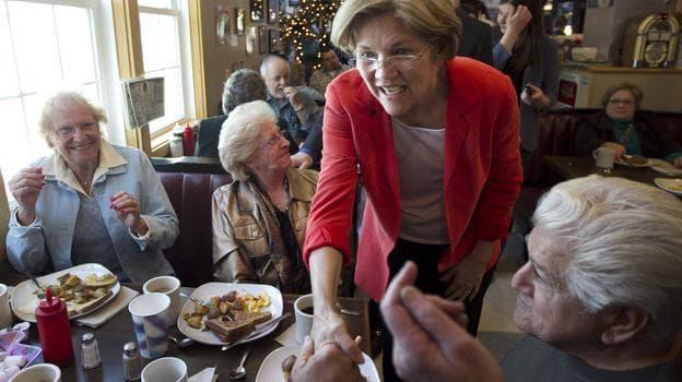 U.S. Senate candidate Elizabeth Warren, a Democrat, greets people at Dinky's Blue Belle Diner in Shrewsbury, Mass., on Sunday. (AP)