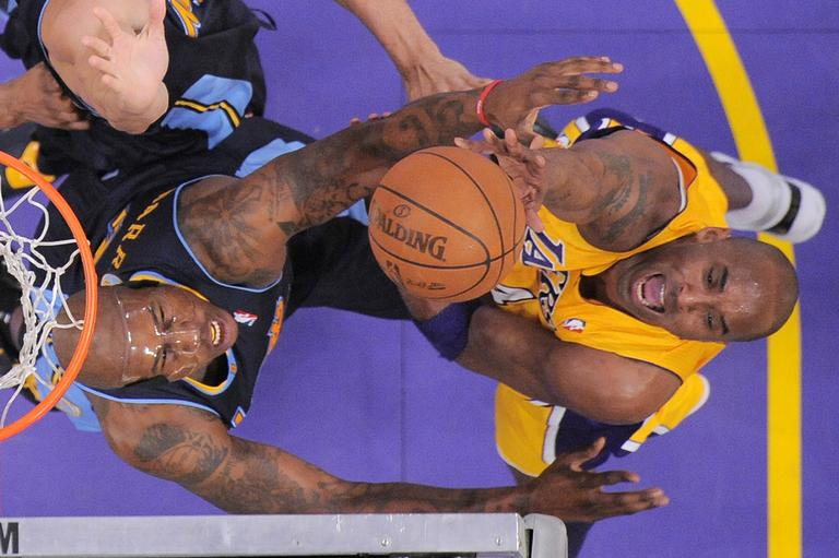 Los Angeles Lakers shooting guard Kobe Bryant, right, puts up a shot as Denver Nuggets power forward Al Harrington defends during the first half in Game 5 of an NBA first-round playoff basketball game, Tuesday, May 8, 2012, in Los Angeles. The Nuggets won 102-99. (AP)