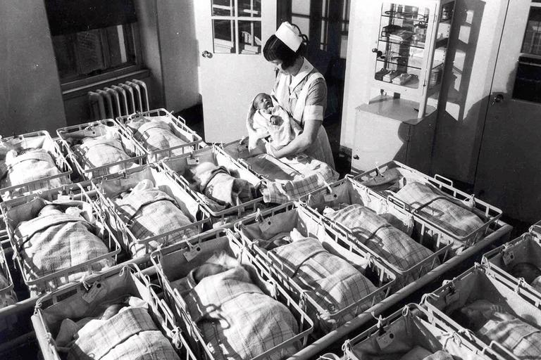 A nurse holds a baby in the nursery of the Pennsylvania Hospital in this 1930 photo. The country has reached a historic tipping point — with minority births constituting more than half of all births, the U.S. Census Bureau reported this month. (AP)