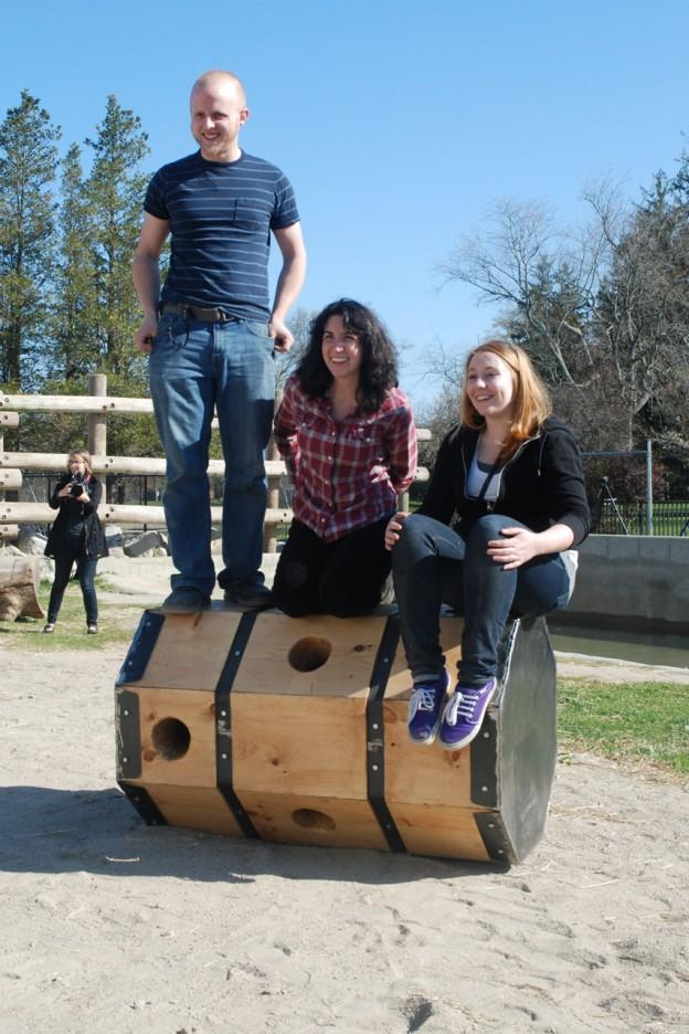 """Alex Stoltze, Jaclyn Bonzagni and Holly Kelly atop the """"octo-log."""" (Susan Hagner for WBUR)"""