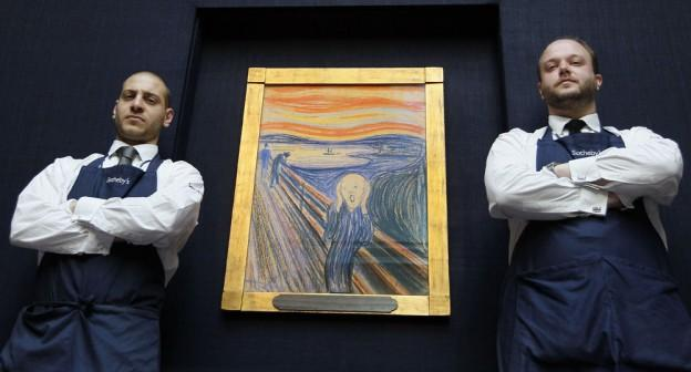 Staff stand guard by Edvard Munch's 'The Scream' as it is hung for display at Sotheby's Auction Rooms in London, Thursday, April 12, 2012. The painting made with pastels is one of four versions of the composition, and dates from 1895, it will be auctioned in the Impressionist and Modern Art Sale in New York on May 2, with an estimated price of 80 million dollars. (AP)