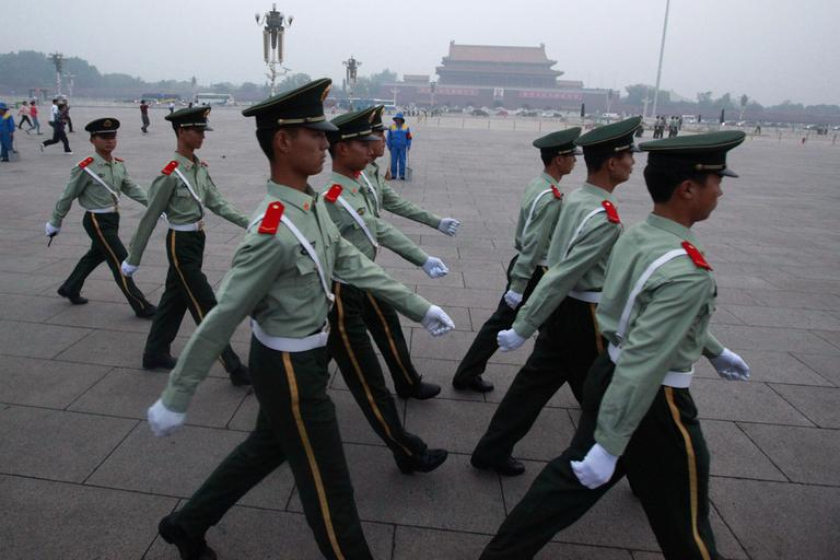 Chinese paramilitary police march on Tiananmen Square after the flag raising ceremony on the June 4 anniversary of the crushing of the 1989 pro-democracy movement centered on the square in Beijing, China. (AP)