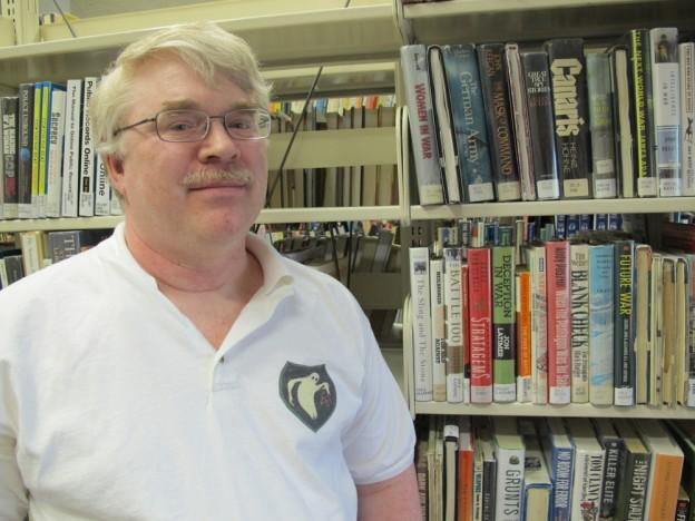 War historian Jonathan Gawne, author of book on the Ghost Army, wearing the Ghost Army's unofficial insignia. (Andrea Shea/WBUR)
