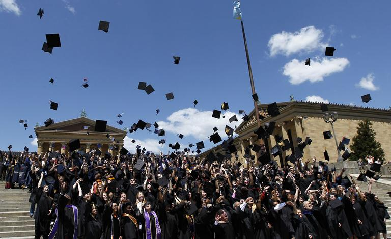Over 300 graduating students from 19 area colleges and universities throw their mortarboards in the air on the steps of the Philadelphia Museum of Art in a ceremony to honor their accomplishments sponsored by Philadelphia Mayor Michael Nutter Friday, May 11, 2012 in Philadelphia. (AP Photo/Alex Brandon)