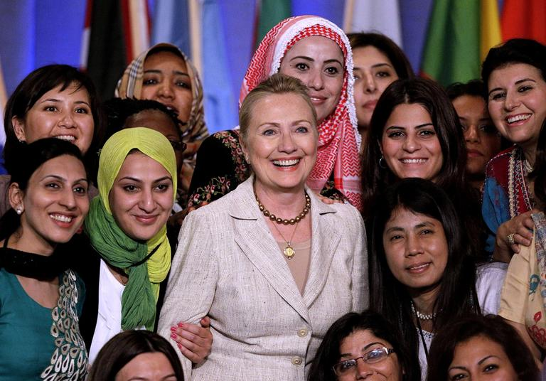 Secretary of State Hillary Clinton poses with a gathering of delegates at the Women in Public Service Institute at Wellesley College Monday. (AP)