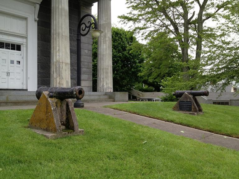 Defensive cannons from the War of 1812 in front of the Barnstable County Courthouse (Adam Raguesa/WBUR)