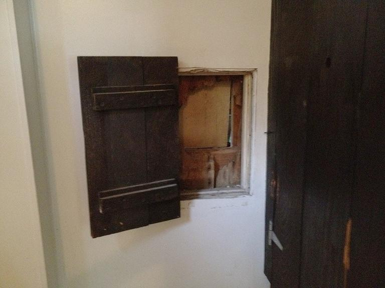 The Nimrod restaurant in Falmouth has preserved the cannon ball hole in the men's room wall behind a small wooden door, from when it was struck in 1814 (Courtesy)
