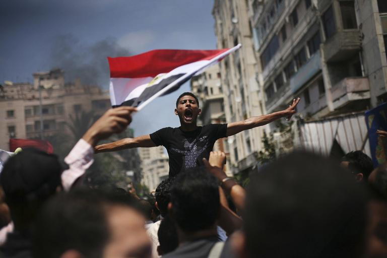 An Egyptian protester chants slogans against presidential candidate Ahmed Safiq during a demonstration against the Supreme Constitutional Court rulings in Alexandria, Egypt, June 15, 2012. Judges appointed by Hosni Mubarak dissolved the Islamist-dominated parliament Thursday and ruled his former prime minister eligible for the presidential runoff election this weekend, setting the stage for the military and remnants of the old regime to stay in power. (AP)