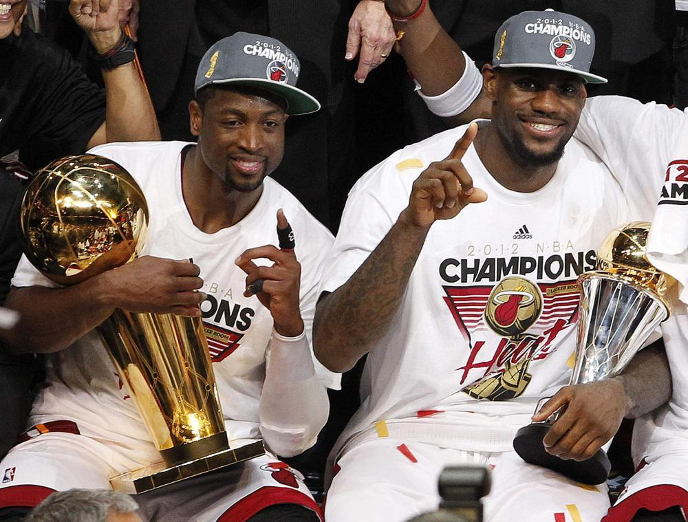 8d8a0aa14d2 The Miami Heat s Dwyane Wade holds the the Larry O Brien NBA Championship  Trophy and