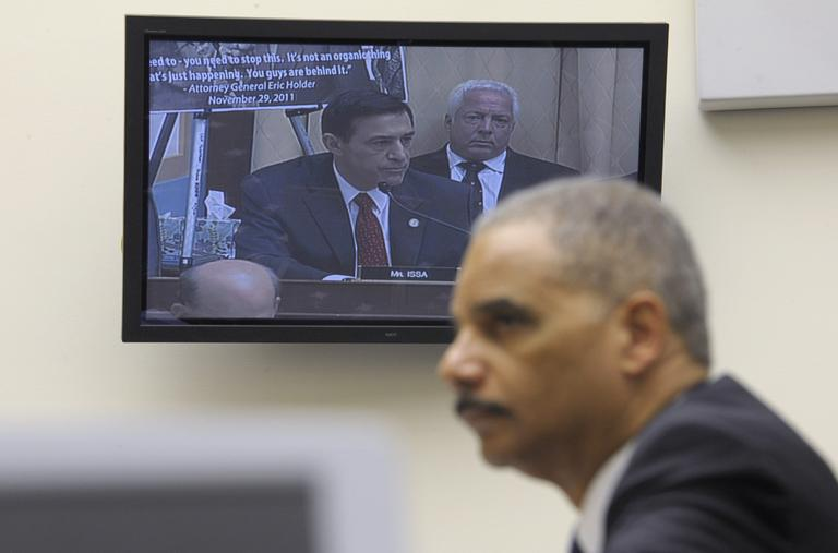 Attorney General Eric Holder listens to Rep. Darryl Issa, R-Calif., on video screen, while testifying on Capitol Hill in Washington, Thursday, Dec. 8, 2011, before the House Judiciary Committee hearing on Operation Fast and Furious. The House voted to find Holder in contempt on June 28, 2012. (AP)