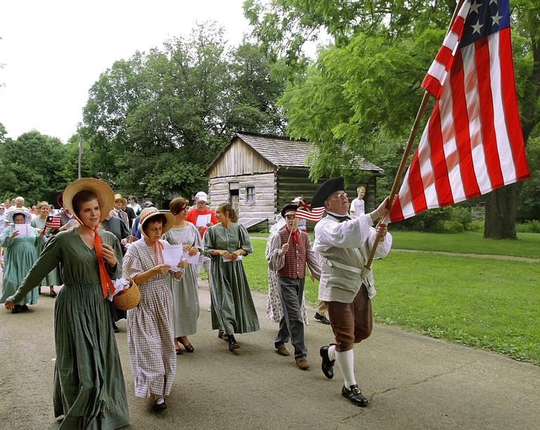 Period interpreters lead the citizen's parade during an Independence Day celebration at Lincoln's New Salem State Historic Site near Petersburg, Ill. (AP)