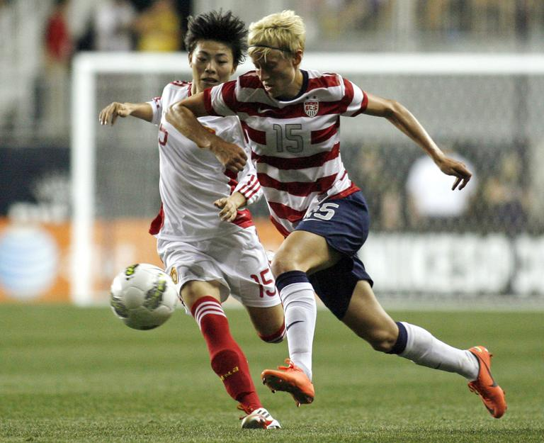U.S. soccer player Megan Rapinoe (15), show here in a friendly match against China in May, recently revealed she is gay. (AP)