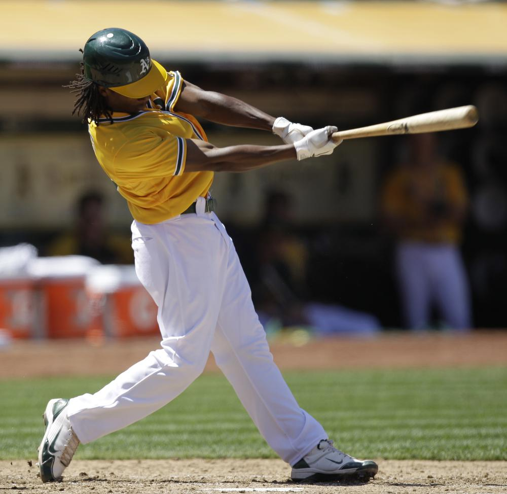 This swing resulted in an RBI for Oakland's Jemile Weeks on July 4, but the A's are struggling again, nearly 23 years since their last World Series title. (AP)