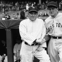 Joe McCarthy, left, manager of the New York Yankees, and Joe Cronin, right, big chief of the Boston Red Sox, are shown just before their teams met, April 16, 1935 in Yankee Stadium, New York, before a crowd of 40,000. (AP Photo)