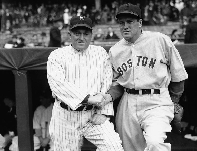 Joe McCarthy, left, manager of the New York Yankees, and Joe Cronin, big chief of the Boston Red Sox, are shown just before their teams met, April 16, 1935 in Yankee Stadium, New York, before a crowd of 40,000. (AP Photo)