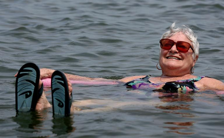 Lillian Mariscalo of Oyster Bay, N.Y. cools off in the waters of an Oyster Bay beach on Long Island's North shore on Saturday. (Craig Ruttle/AP)