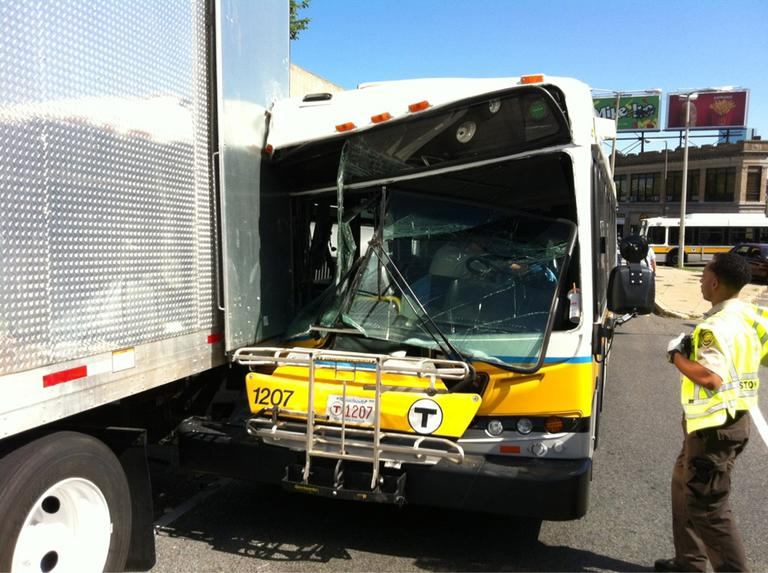 An MBTA bus crashed into a movie production truck in Roxbury. (John Atwater/WCVB-TV)