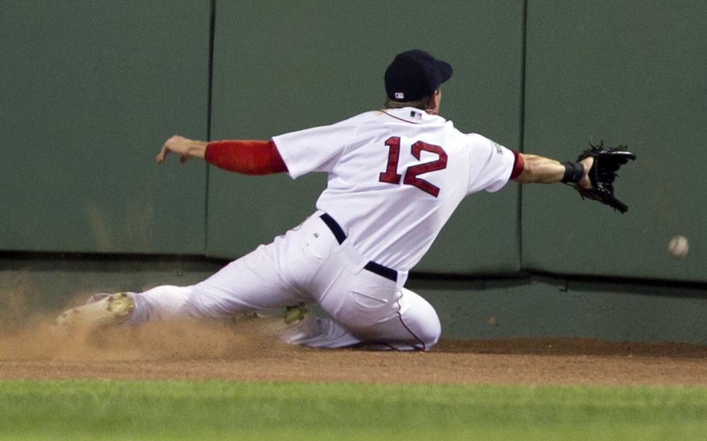 Boston's Ryan Sweeney is unable to get his glove on an RBI triple hit by New York Yankees' Alex Rodriguez in yesterday's game at Fenway. (AP Photo)