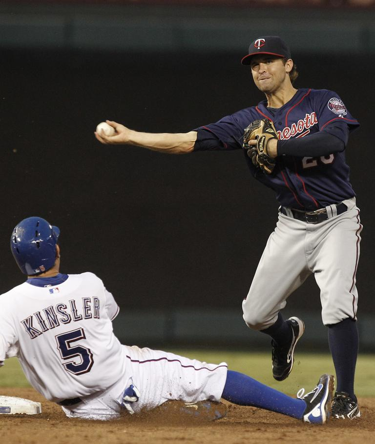 Minnesota Twins shortstop Brian Dozier (20) and Texas Rangers Ian Kinsler (5) during a baseball game in Arlington, Texas. (AP)