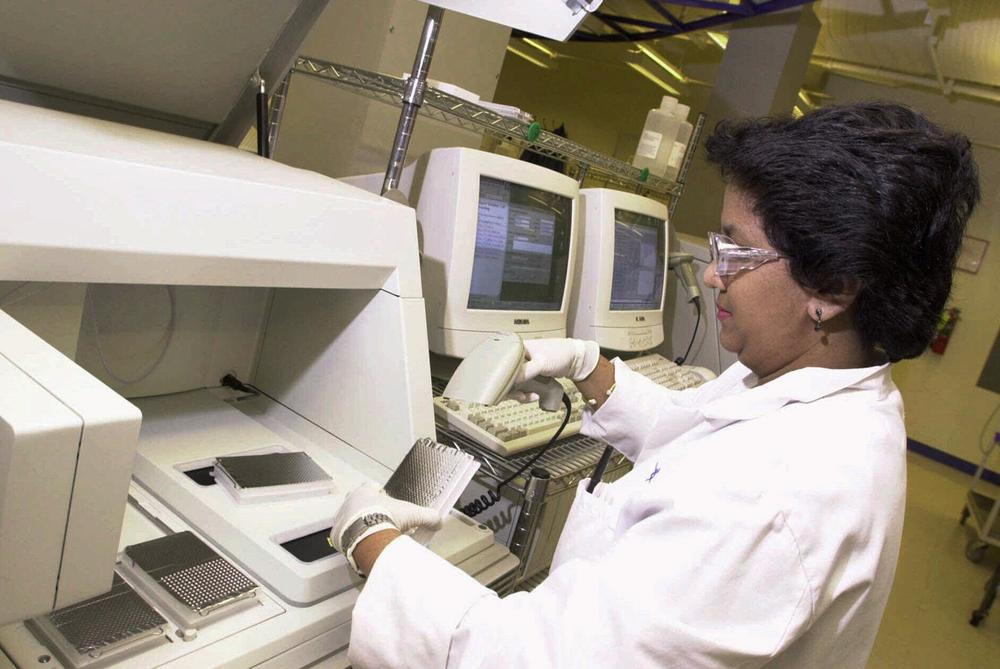 Nini Tint, a technician for Celera Genomics, loads DNA samples onto a DNA Sequencer machine in the company's Rockville, Md., lab. (AP)