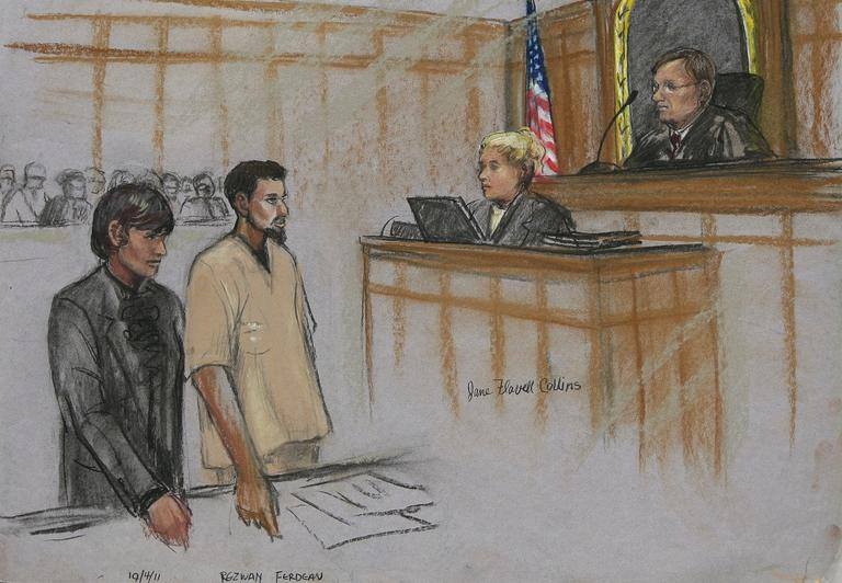 In this courtroom sketch, Rezwan Ferdaus, second from left, and his attorney Catherine Byrne, left, stand during Ferdaus' arraignment hearing in federal court in Worcester Monday afternoon, Oct. 3, 2011. (AP)