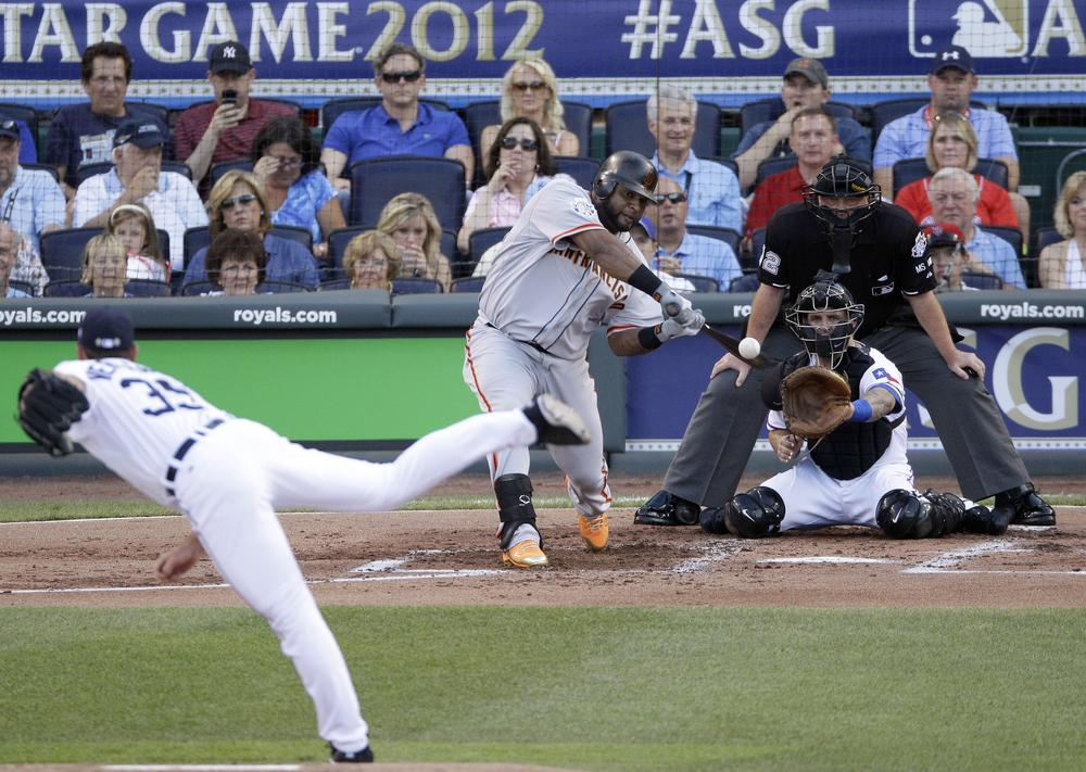 National League's Pablo Sandoval, of the San Francisco Giants, hits a three-run triple on a pitch by American League's Justin Verlander, of the Detroit Tigers, in the first inning of the All-Star game. (AP)