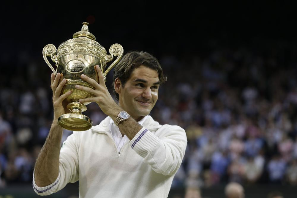 Roger Federer's seventh Wimbledon championship wasn't just a win for him and his fans. It paid major dividend for a charity that helps people all over the world, thanks to one fan's wager. (AP)