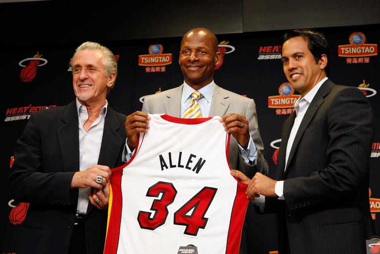 From left: Miami Heat president Pat Riley, Ray Allen and head coach Erik Spoelstra hold up Allen's jersey after the former Celtic signed a contract with the Heat Wednesday. (AP)
