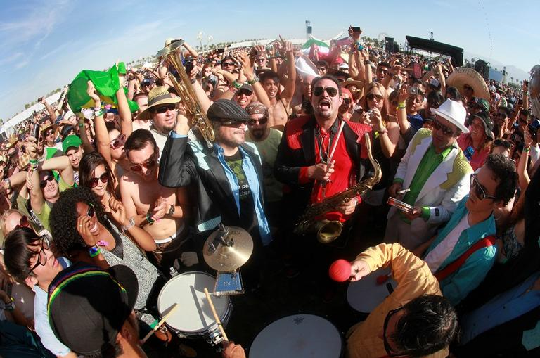 Ozomatli performs from the fan's viewing area during their set at Coachella Valley Music and Arts Festival, Friday, April 15 2011, in Indio, Calif. (AP)