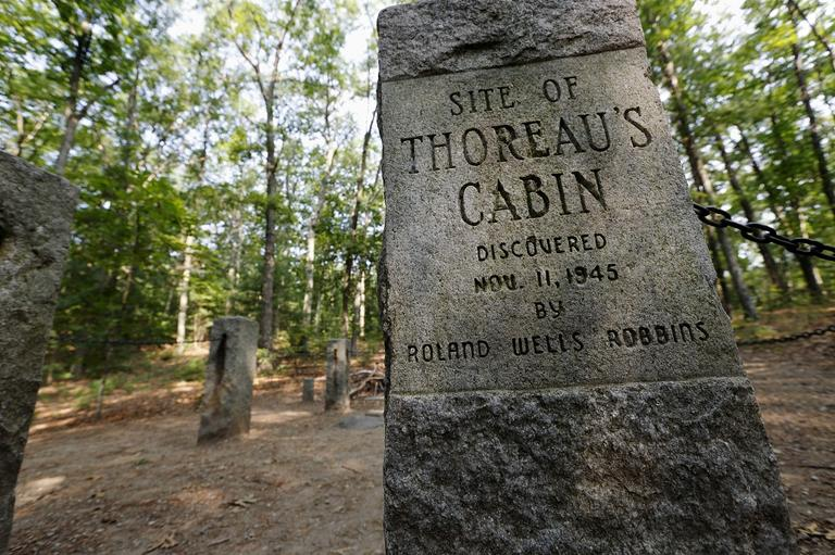 In this photo taken Friday, July 13, 2012, stone pillars delineate the actual site of Henry David Throeau's cabin on the shores of Walden Pond in Concord, Mass. (Michael Dwyer/AP)