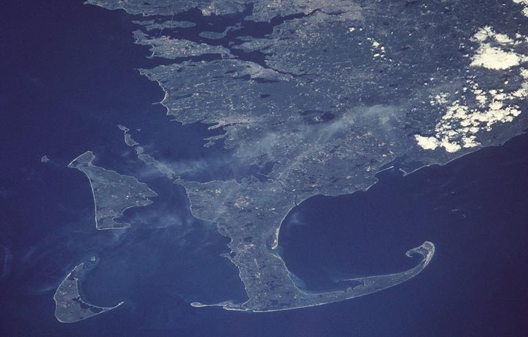 This is a June 1998 NASA handout photo showing Cape Cod, the island of Martha's Vineyard, left, and the island of Nantucket, left-bottom, in a view from space. (AP Photo/NASA)