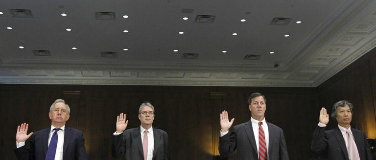 "From left, David Bagley, Head of Group Compliance of HSBC Holdings plc, Paul Thurston, chief executive of Retail Banking and Wealth Management HSBC Holdings plc, Michael Gallagher, former executive Vice President and head of PCM North America HSBC Bank USA, N.A., and Christopher Lok, former head of Global Banknotes for HSBC Bank USA, N.A., are sworn in prior to testifying before the permanent Subcommittee on Investigations hearing, ""U.S. Vulnerabilities to Money Laundering, Drugs, and Terrorist Financing: HSBC Case History,"" Tuesday, July 17, 2012, on Capitol Hill in Washington. (AP)"