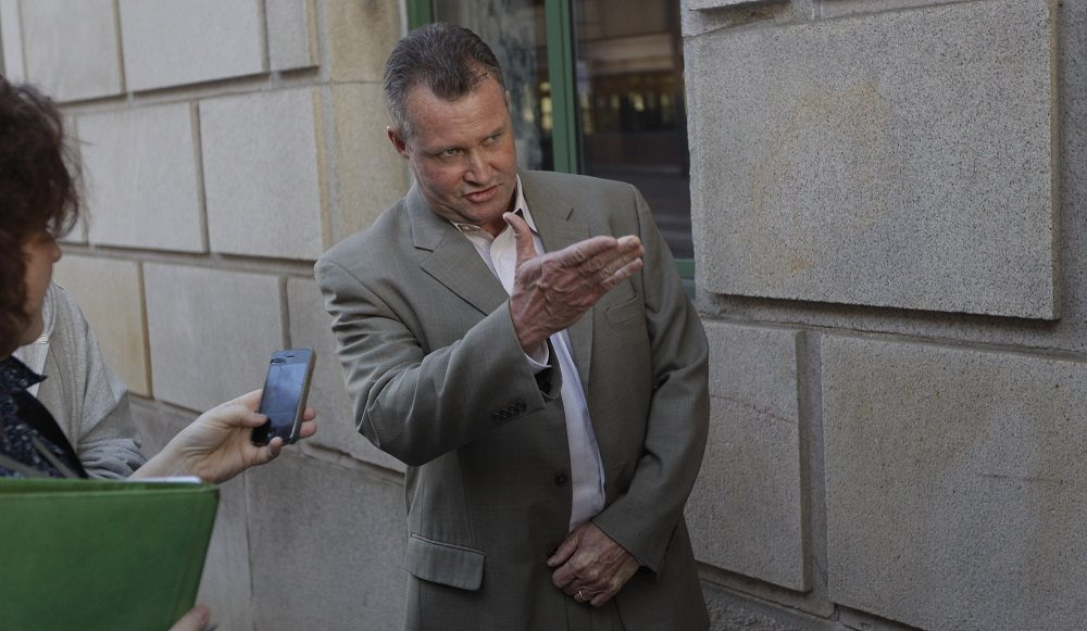 John O'Brien, former Massachusetts probation department commissioner, stands outside a Federal Courthouse in 2012 (AP/Stephan Savoia).