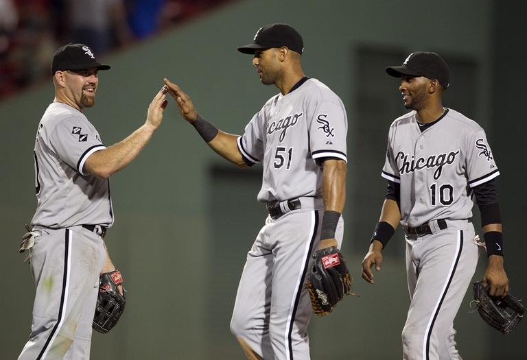 Chicago White Sox's Kevin Youkilis, left, celebrates with teammates Alex Rios, center, and Alexei Ramirez, right, after defeating the Red Sox 7-5 on Tuesday. (AP Photo/Steven Senne)