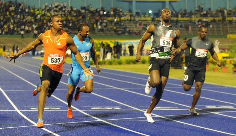 World champion Yohan Blake, left, celebrates after crossing the finish line ahead of current world-record holder Usain Bolt, second from right, Nesta Carter, right, and Michael Frater to win the 100m final at Jamaica's Olympic trials in Kingston, Jamaica. (AP)