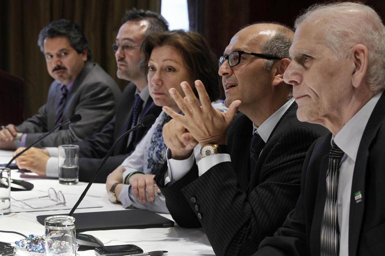 Dr. George Netto, a member of the Syrian National Council, second right, addresses a news conference in New York on Tuesday. Also participating are, from left: Najib Ghadbian, Khalid Saleh, Bassma Kodmani, and Samir Shishakli, members of the SNC delegation. (AP)