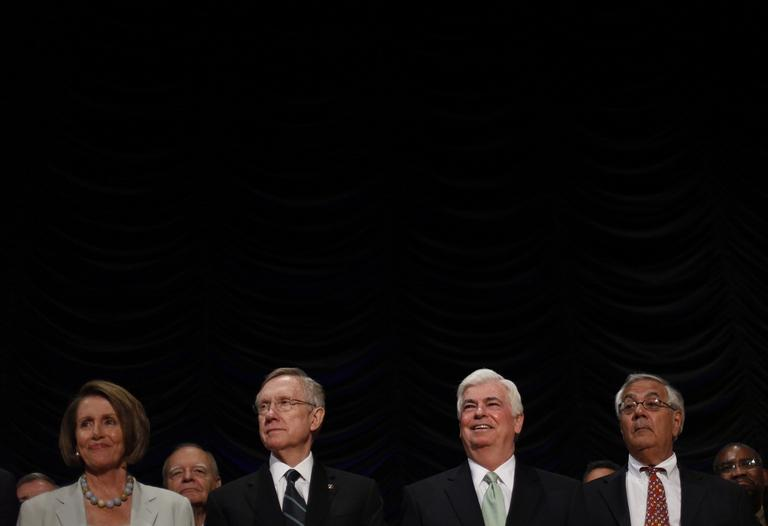 From left to right, Rep. Nancy Pelosi, Senate Majority Leader Harry Reid, Sen. Chris Dodd, and Rep. Barney Frank, on stage at the signing of the Dodd-Frank Wall Street Reform and Consumer Protection Act in 2010. (AP)