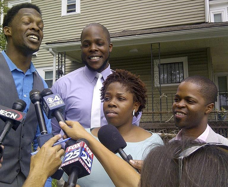 Children of the Rev. Michel Louis, from left: Daniel Louis,, Nathaniel Louis, Debora Luois, and Jean Louis, speak to the media in Boston after talking to their father via satellite phone from Egypt following his release Monday. (AP)