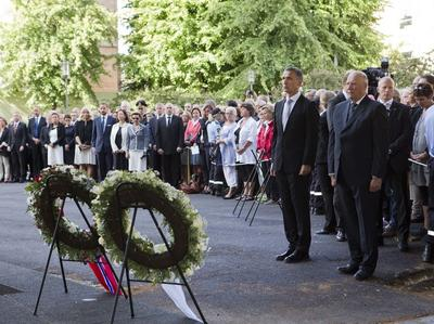 Norwegian Prime Minister Jens Stoltenberg (left) and King Harald attend a memorial ceremony near a government building damaged by a bomb attack in Oslo, Norway, Sunday. (AP)