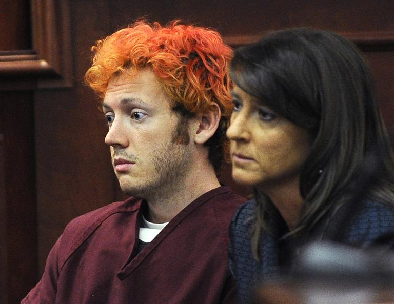 James E. Holmes, left, appears in Arapahoe County District Court, with defense attorney Tamara Brady, right, Monday, July 23, 2012, in Centennial, Colo. Holmes is being held on suspicion of first-degree murder, and could also face additional counts of aggravated assault and weapons violations stemming from a mass shooting on Friday, July 20, in a movie theater in Aurora, Colo., that killed 12 and injured dozens of others. (AP)