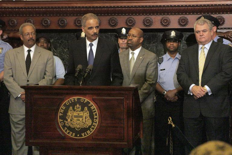 Attorney General Eric Holder addresses the media at Philadelphia City Hall on Monday after Holder announced more than $111 million in funding for more than 800 law enforcement positions across the country, including 44 in cities in Pennsylvania, through the U.S. Department of Justice Office of Community Oriented Policing Services. (AP)